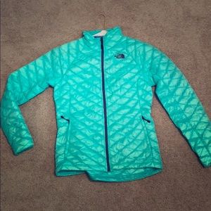 Teal north face zip up